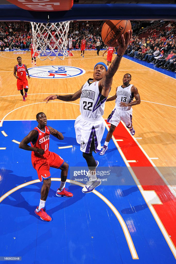 Isaiah Thomas #22 of the Sacramento Kings shoots a layup against <a gi-track='captionPersonalityLinkClicked' href=/galleries/search?phrase=Jrue+Holiday&family=editorial&specificpeople=5042484 ng-click='$event.stopPropagation()'>Jrue Holiday</a> #11 of the Philadelphia 76ers during the game at the Wells Fargo Center on February 1, 2013 in Philadelphia, Pennsylvania.