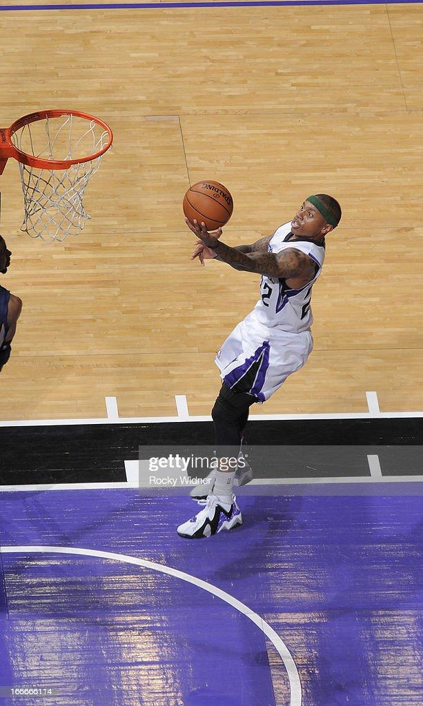 Isaiah Thomas #22 of the Sacramento Kings shoots a layup against the Memphis Grizzlies on April 7, 2013 at Sleep Train Arena in Sacramento, California.
