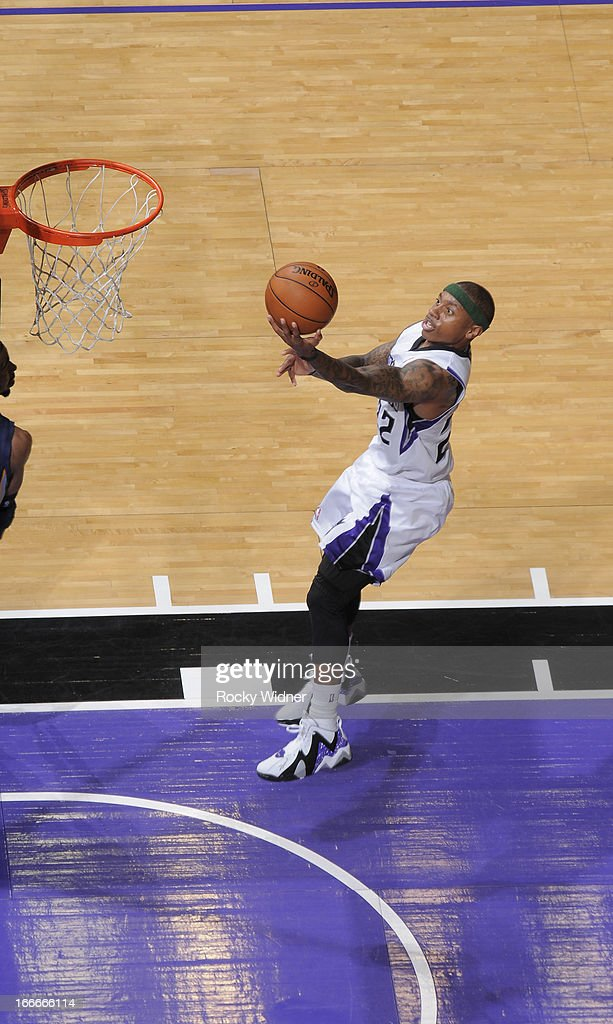 Isaiah Thomas #22 of the Sacramento Kings shoots a layup against the Memphis Grizzlies on April 7, 2013 at Sleep Train Arena in Sacramento, California.