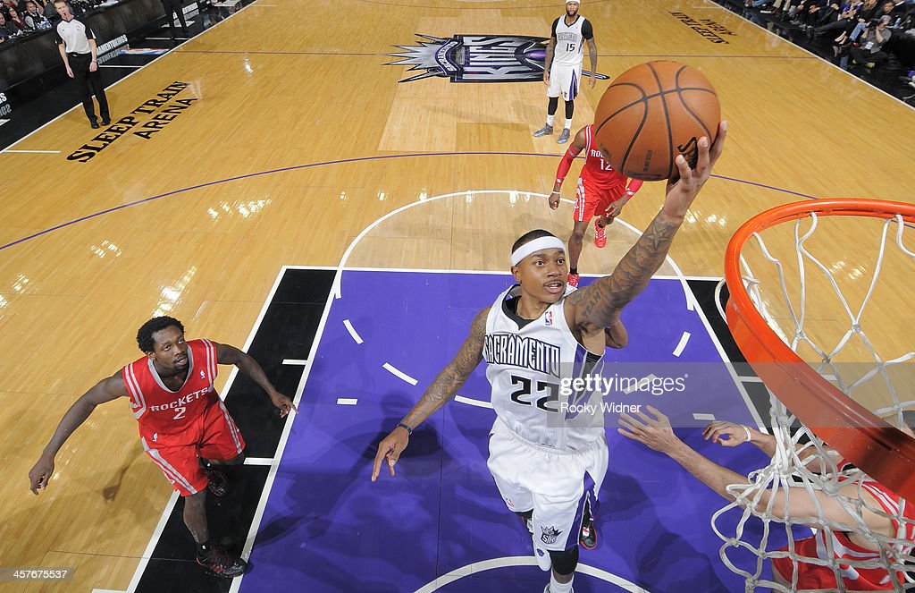 Isaiah Thomas #22 of the Sacramento Kings shoots a layup against the Houston Rockets on December 15, 2013 at Sleep Train Arena in Sacramento, California.