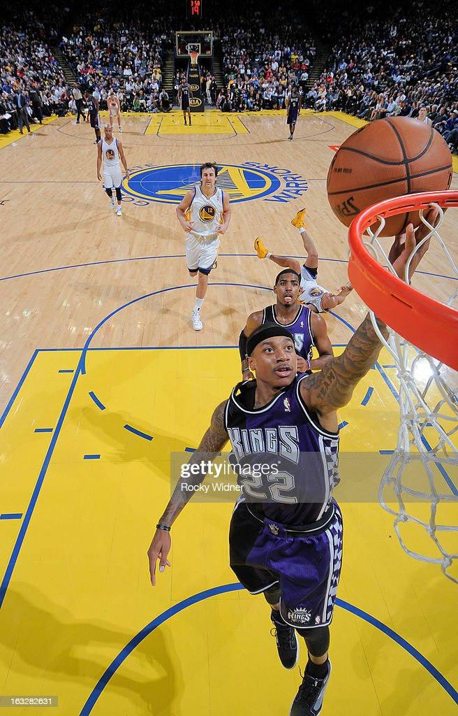 Isaiah Thomas #22 of the Sacramento Kings shoots a layup on a fast break against the Golden State Warriors on March 6, 2013 at Oracle Arena in Oakland, California.