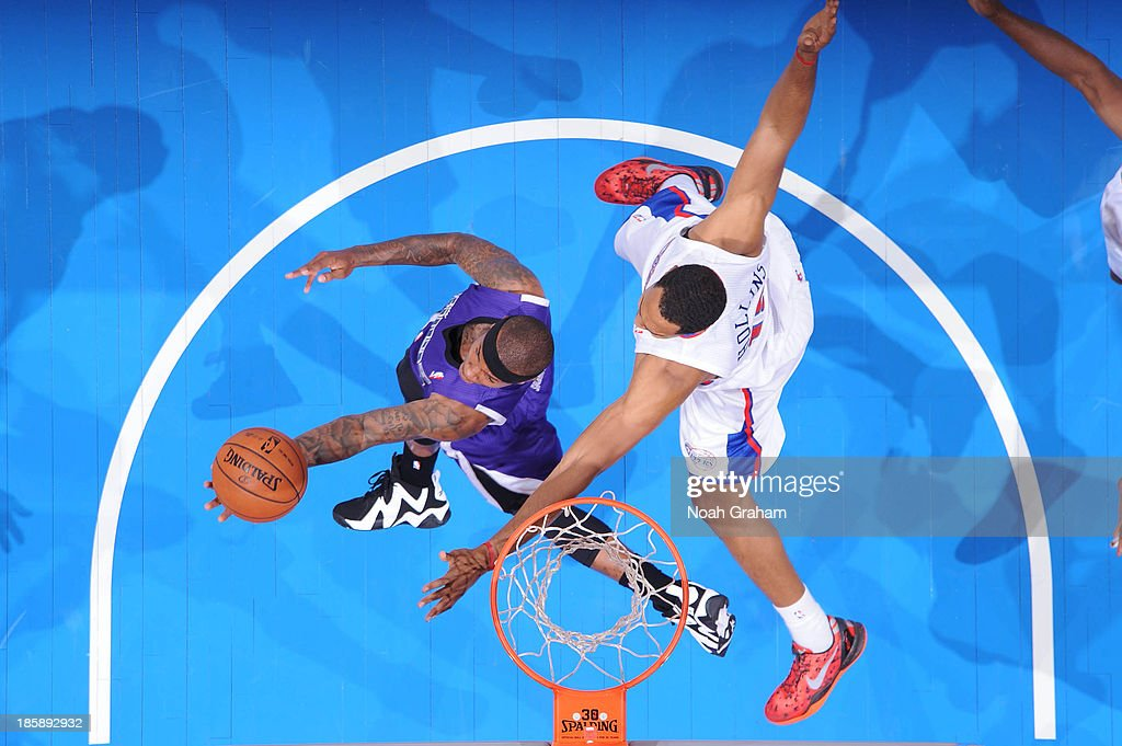 Isaiah Thomas #22 of the Sacramento Kings shoots a reverse layup against <a gi-track='captionPersonalityLinkClicked' href=/galleries/search?phrase=Ryan+Hollins&family=editorial&specificpeople=182556 ng-click='$event.stopPropagation()'>Ryan Hollins</a> #15 of the Los Angeles Clippers at Staples Center on October 25, 2013 in Los Angeles, California.