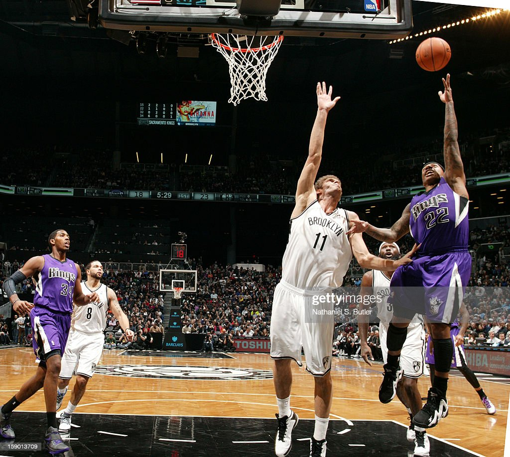 Isaiah Thomas #22 of the Sacramento Kings shoots against Brook Lopez #11 of the Brooklyn Nets on January 5, 2013 at the Barclays Center in the Brooklyn borough of New York City.