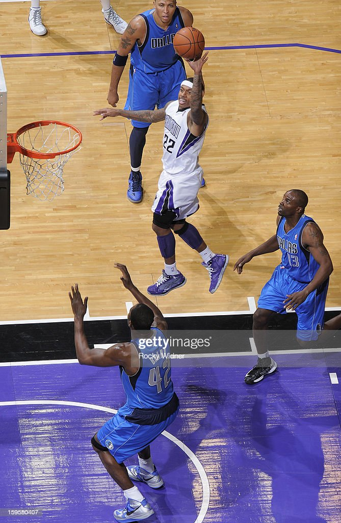 Isaiah Thomas #22 of the Sacramento Kings shoots against <a gi-track='captionPersonalityLinkClicked' href=/galleries/search?phrase=Elton+Brand&family=editorial&specificpeople=201501 ng-click='$event.stopPropagation()'>Elton Brand</a> #42 and <a gi-track='captionPersonalityLinkClicked' href=/galleries/search?phrase=Mike+James+-+Basketspelare+-+F%C3%B6dd+1975&family=editorial&specificpeople=13541391 ng-click='$event.stopPropagation()'>Mike James</a> #13 of the Dallas Mavericks on January 10, 2013 at Sleep Train Arena in Sacramento, California.