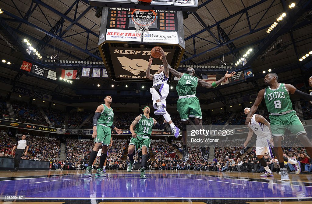 Isaiah Thomas #22 of the Sacramento Kings shoots against Kevin Garnett #5 of the Boston Celtics on December 30, 2012 at Sleep Train Arena in Sacramento, California.
