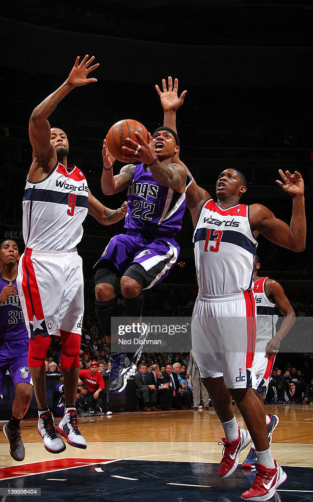 Isaiah Thomas #22 of the Sacramento Kings shoots against <a gi-track='captionPersonalityLinkClicked' href=/galleries/search?phrase=Kevin+Seraphin&family=editorial&specificpeople=6474998 ng-click='$event.stopPropagation()'>Kevin Seraphin</a> #13 and <a gi-track='captionPersonalityLinkClicked' href=/galleries/search?phrase=Rashard+Lewis&family=editorial&specificpeople=201713 ng-click='$event.stopPropagation()'>Rashard Lewis</a> #9 of the Washington Wizards during the game at the Verizon Center on February 22, 2012 in Washington, DC.