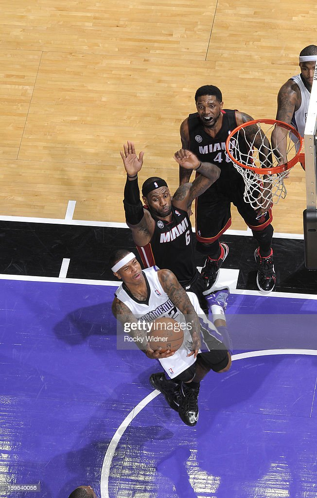 Isaiah Thomas #22 of the Sacramento Kings shoots against <a gi-track='captionPersonalityLinkClicked' href=/galleries/search?phrase=LeBron+James&family=editorial&specificpeople=201474 ng-click='$event.stopPropagation()'>LeBron James</a> #6 of the Miami Heat on January 12, 2013 at Sleep Train Arena in Sacramento, California.