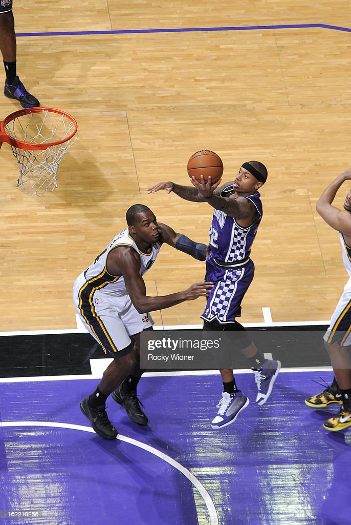 Isaiah Thomas #22 of the Sacramento Kings shoots against <a gi-track='captionPersonalityLinkClicked' href=/galleries/search?phrase=Paul+Millsap&family=editorial&specificpeople=880017 ng-click='$event.stopPropagation()'>Paul Millsap</a> #24 of the Utah Jazz on February 9, 2013 at Sleep Train Arena in Sacramento, California.