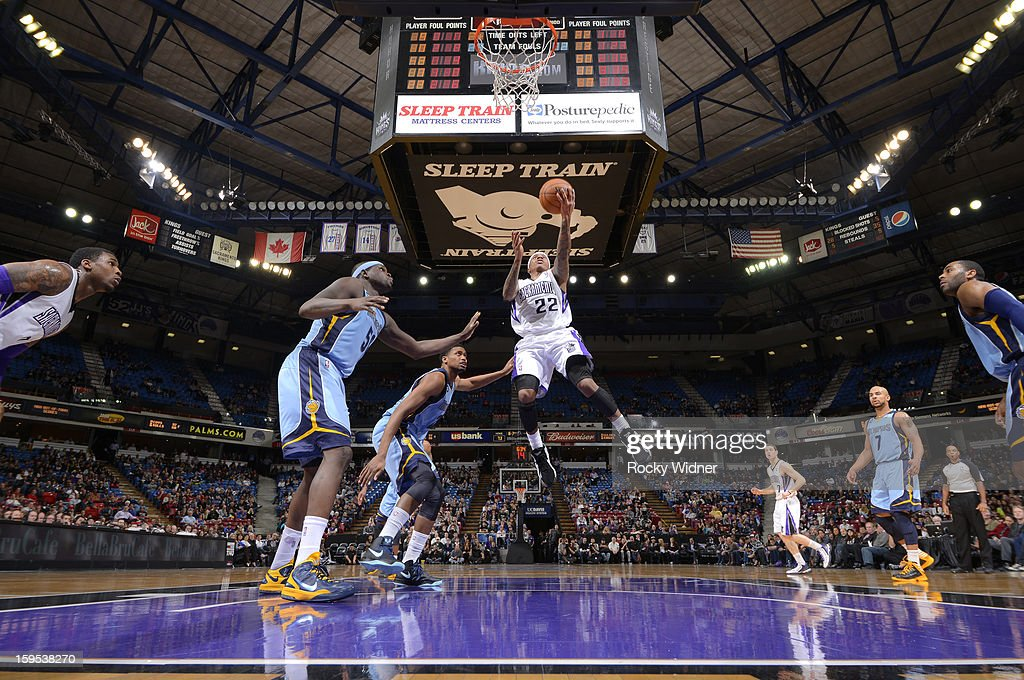 Isaiah Thomas #22 of the Sacramento Kings shoots against <a gi-track='captionPersonalityLinkClicked' href=/galleries/search?phrase=Rudy+Gay&family=editorial&specificpeople=236066 ng-click='$event.stopPropagation()'>Rudy Gay</a> #22 and <a gi-track='captionPersonalityLinkClicked' href=/galleries/search?phrase=Zach+Randolph&family=editorial&specificpeople=201595 ng-click='$event.stopPropagation()'>Zach Randolph</a> #50 of the Memphis Grizzlies on January 7, 2013 at Sleep Train Arena in Sacramento, California.