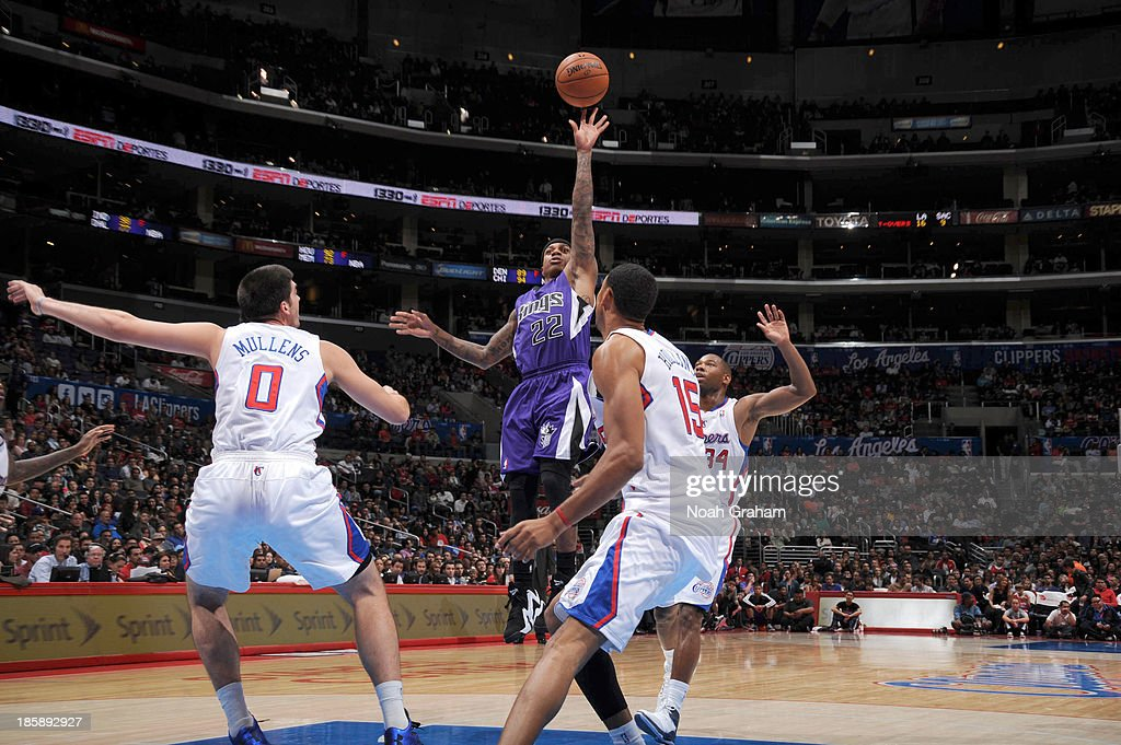 Isaiah Thomas #22 of the Sacramento Kings shoots against <a gi-track='captionPersonalityLinkClicked' href=/galleries/search?phrase=Ryan+Hollins&family=editorial&specificpeople=182556 ng-click='$event.stopPropagation()'>Ryan Hollins</a> #15 of the Los Angeles Clippers at Staples Center on October 25, 2013 in Los Angeles, California.