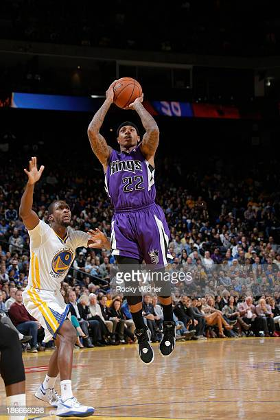 Isaiah Thomas of the Sacramento Kings shoots against Toney Douglas of the Golden State Warriors on November 2 2013 at Oracle Arena in Oakland...