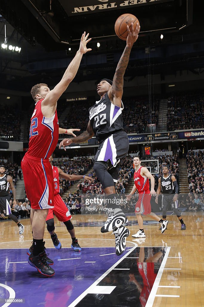 Isaiah Thomas #22 of the Sacramento Kings shoots the ball against Blake Griffin #32 of the Los Angeles Clippers at Sleep Train Arena on November 1, 2013 in Sacramento, California.