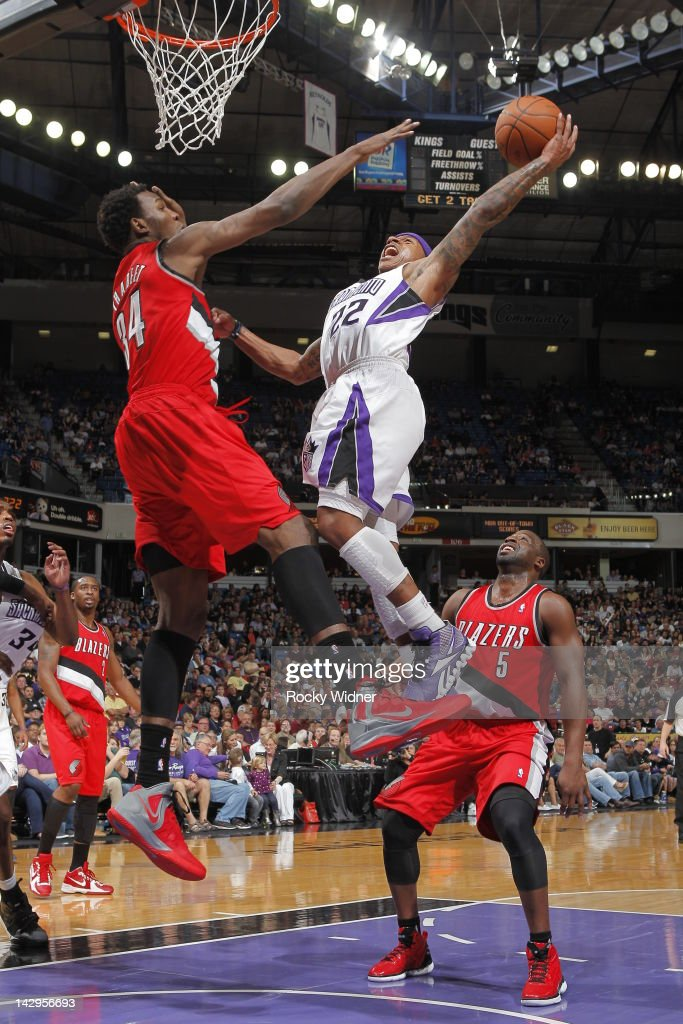 Isaiah Thomas #22 of the Sacramento Kings shoots the ball against <a gi-track='captionPersonalityLinkClicked' href=/galleries/search?phrase=Hasheem+Thabeet&family=editorial&specificpeople=4003778 ng-click='$event.stopPropagation()'>Hasheem Thabeet</a> #34 of the Portland Trail Blazers on April 15, 2012 at Power Balance Pavilion in Sacramento, California.