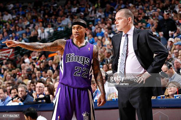 Isaiah Thomas of the Sacramento Kings speaks with head coach Michael Malone against the Dallas Mavericks on January 31 2014 at the American Airlines...