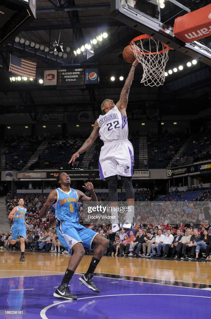 Isaiah Thomas #22 of the Sacramento Kings takes the ball to the basket against Al-Farouq Aminu #0 of the New Orleans Hornets on April 10, 2013 at Sleep Train Arena in Sacramento, California.