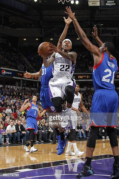 Isaiah Thomas of the Sacramento Kings takes the ball to the basket against Thaddeus Young of the Philadelphia 76ers at Sleep Train Arena on January 2...