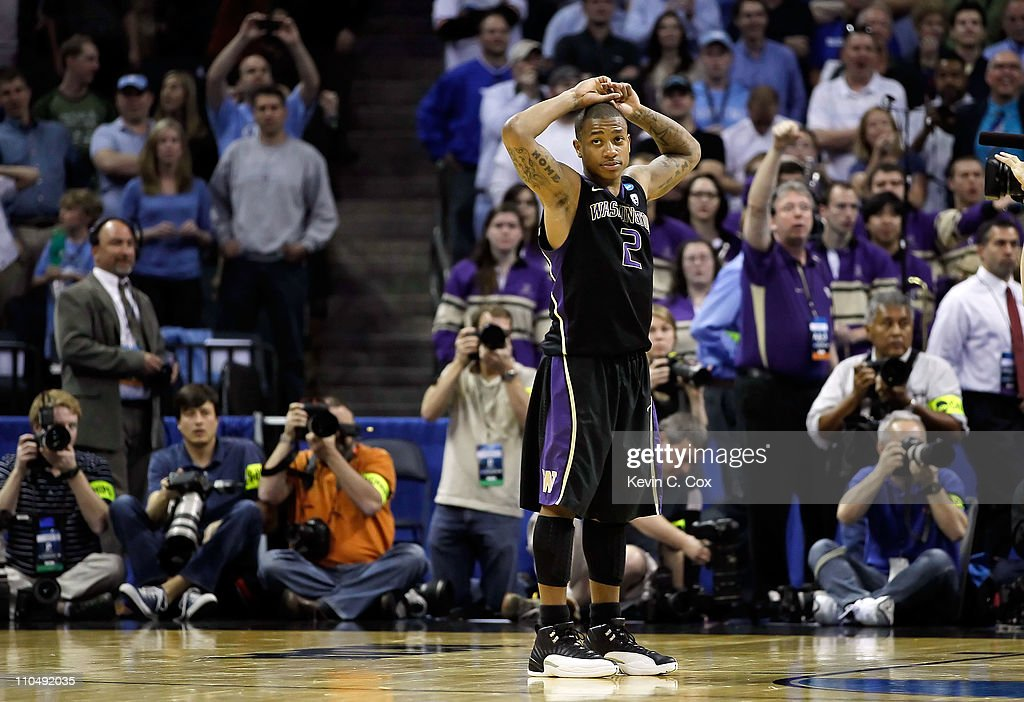 Isaiah Thomas #2 of the Washington Huskies reacts after the Huskies were defeated 86-83 by the North Carolina Tar Heels during the third round of the 2011 NCAA men's basketball tournament at Time Warner Cable Arena on March 20, 2011 in Charlotte, North Carolina.