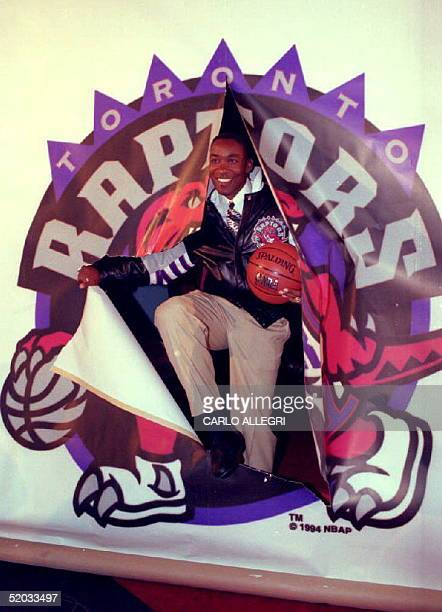 Isaiah Thomas who retired earlier this month after 13 seasons with the Detroit Pistons bursts through a Toronto Raptors logo at a press conference 24...