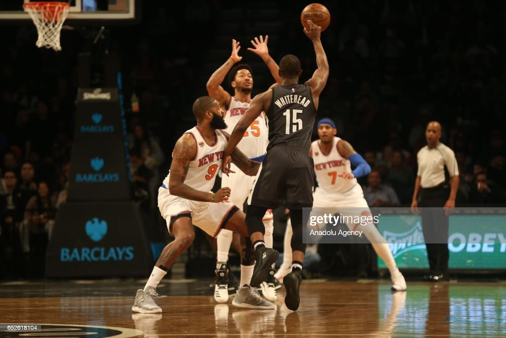 Isaiah Whitehead #15 blocked by (L) Kyle O'Quinn of New York Knicks during Brooklyn Nets vs New York Knicks NBA game in Barclays Center in Brooklyn borough of New York , U.S.A on March 12, 2017.
