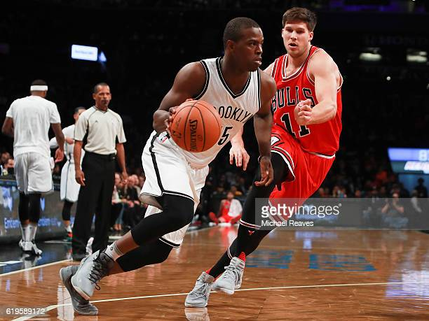 Isaiah Whitehead of the Brooklyn Nets drives to the basket on Doug McDermott of the Chicago Bulls during the first half at Barclays Center on October...