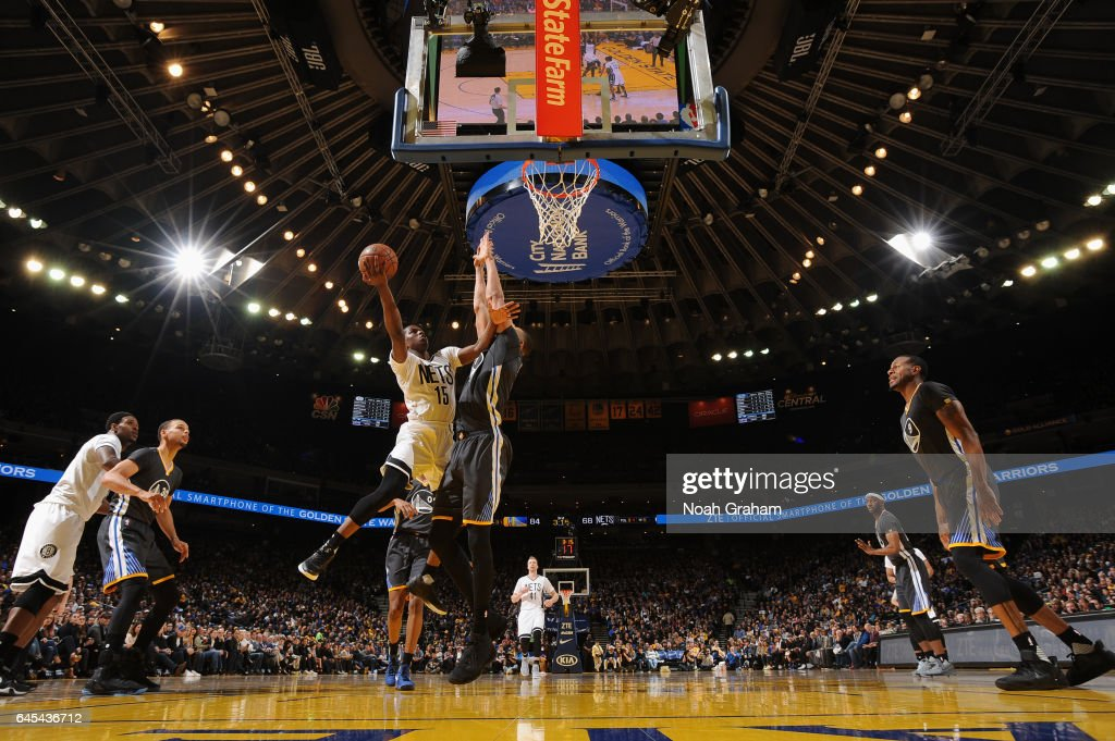 Isaiah Whitehead #15 of the Brooklyn Nets goes to the basket against the Golden State Warriors on February 25, 2017 at ORACLE Arena in Oakland, California.