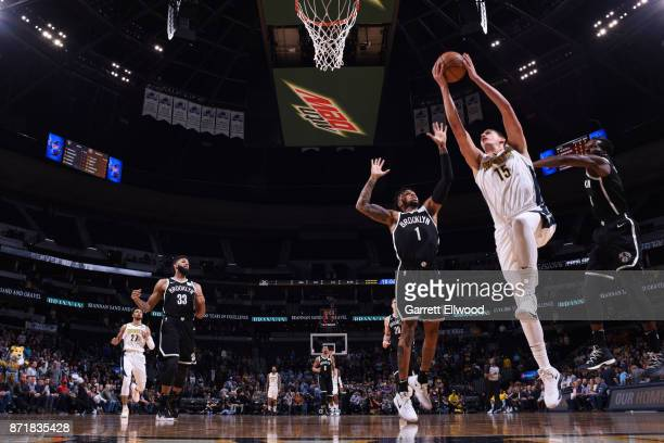 Isaiah Whitehead of the Brooklyn Nets shoots the ball against D'Angelo Russell of the Brooklyn Nets on November 7 2017 at the Pepsi Center in Denver...