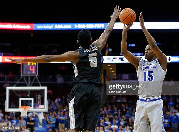 Isaiah Whitehead of the Seton Hall Pirates attempts a three point shot as Rodney Bullock of the Providence Friars defends during the second half of...