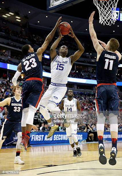 Isaiah Whitehead of the Seton Hall Pirates goes up against Eric McClellan and Domantas Sabonis of the Gonzaga Bulldogs in the second half during the...