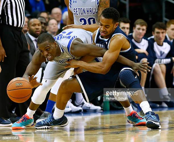 Isaiah Whitehead of the Seton Hall Pirates looses the ball as Phil Booth of the Villanova Wildcats defend during the second half of an NCAA college...