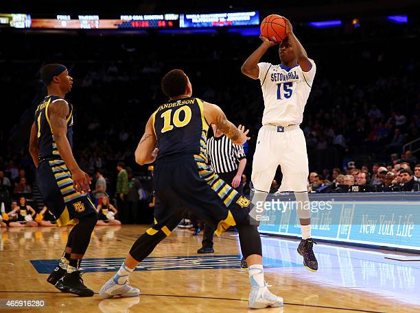 Isaiah Whitehead of the Seton Hall Pirates takes a shot as Juan Anderson of the Marquette Golden Eagles defends during a first round game of the Big...