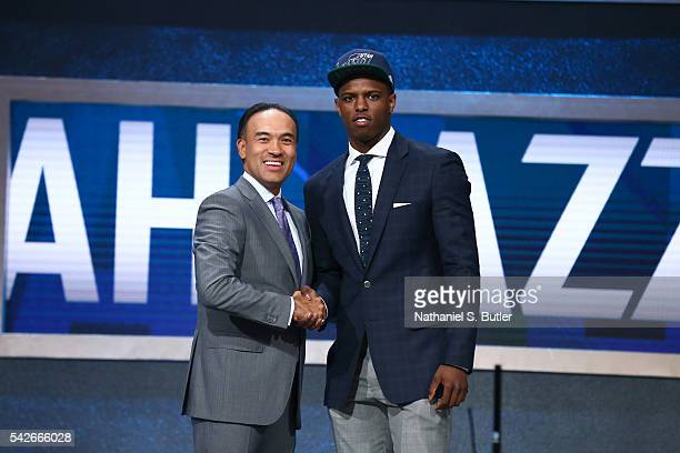 Isaiah Whitehead shakes hands with NBA Deputy Commissioner and Chief Operating Officer Mark Tatum after being selected number forty second overall by...