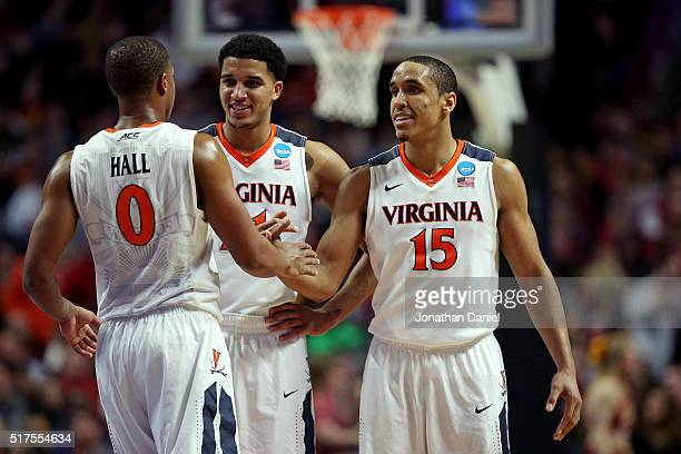 Isaiah Wilkins Devon Hall and Malcolm Brogdon of the Virginia Cavaliers celebrate in the second half against the Iowa State Cyclones during the 2016...