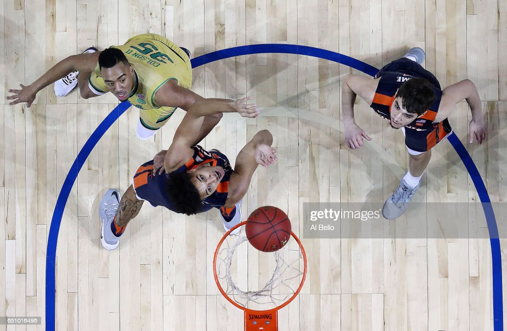 Isaiah Wilkins #21 of the Virginia Cavaliers against the Notre Dame Fighting Irish Bonzie Colson #35 of the Notre Dame Fighting Irish battle for the ball during the Quarterfinals of the ACC Basketball Tournament at the Barclays Center on March 9, 2017 in New York City.