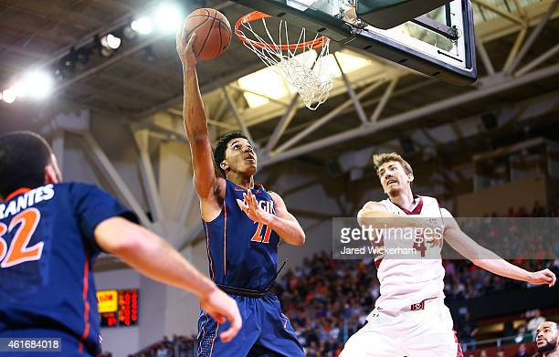 Isaiah Wilkins of the Virginia Cavaliers goes up for a layup in the second half in front of Eddie Odio of the Boston College Eagles during the game...