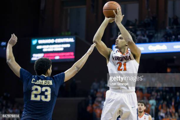 Isaiah Wilkins of the Virginia Cavaliers shoots the ball over Cameron Johnson of the Pittsburgh Panthers during a game at John Paul Jones Arena on...