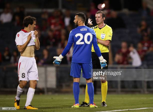 Isaias and United goalkeeper Paul Izzo argue with referee Peter Green after he awarded a penalty to the Wanderers during the FFA Cup Semi Final match...