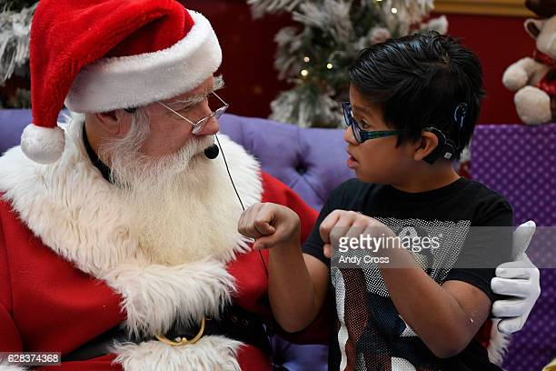 Isaias Castro signs to a signing Santa at the Cherry Creek Mall December 07 2016 Over 275 deaf and hard of hearing area school children visited sign...