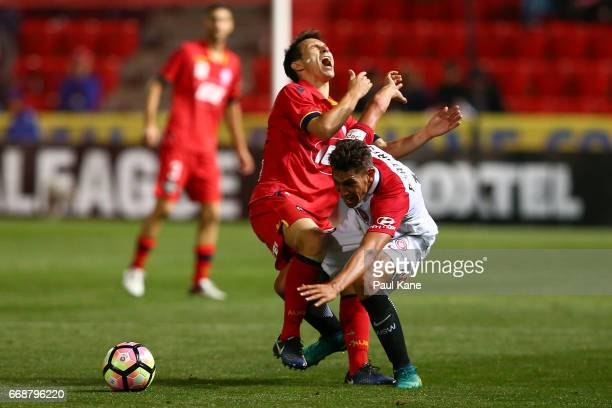 Isaias of Adelaide and Bruno Pinatares of the Wanderers contest for the ball during the round 27 ALeague match between Adelaide United and the...