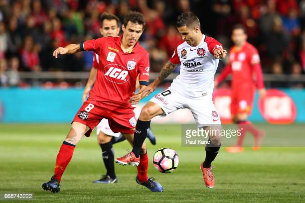 Isaias of Adelaide and Nicolas Martinez of the Wanderers contest for the ball during the round 27 ALeague match between Adelaide United and the...