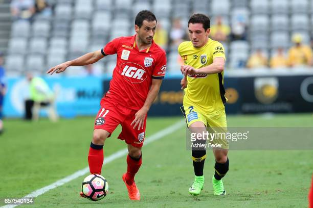 Isaias of Adelaide contests the ball against Storm Roux of the Mariners during the round 24 ALeague match between Central Coast Mariners and Adelaide...