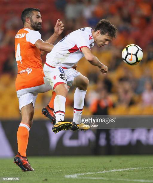 Isaias of Adelaide heads the ball during the round two ALeague match between the Brisbane Roar and Adelaide United at Suncorp Stadium on October 13...
