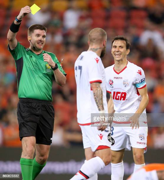 Isaias of Adelaide reacts to the yellow card of team mate Daniel Adlung from referee Adam Keresey during the round two ALeague match between the...