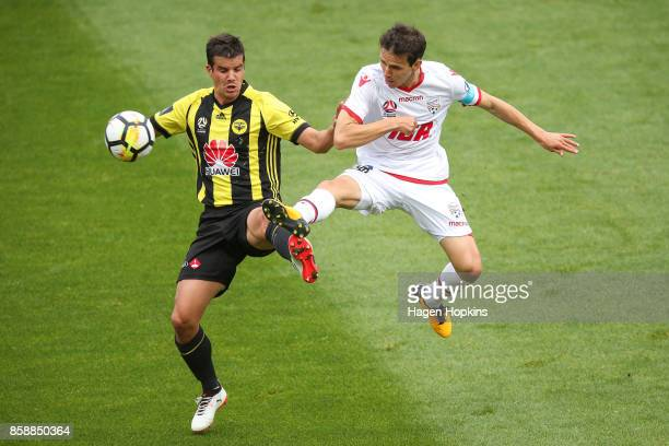 Isaias of Adelaide United and Andrija Kaludjerovic of the Phoenix compete for the ball during the round one ALeague match between Wellington Phoenix...