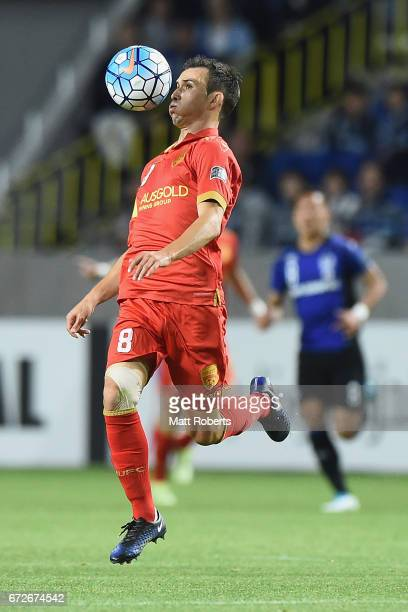 Isaias of Adelaide United competes for the ball during the AFC Champions League Group H match between Gamba Osaka v Adelaide United at Suita City...