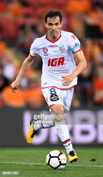 Isaias of Adelaide United dribbles the ball during the round two ALeague match between the Brisbane Roar and Adelaide United at Suncorp Stadium on...