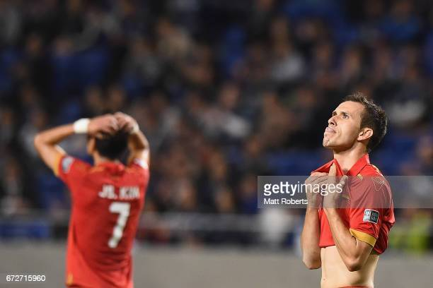 Isaias of Adelaide United looks dejected during the AFC Champions League Group H match between Gamba Osaka v Adelaide United at Suita City Football...