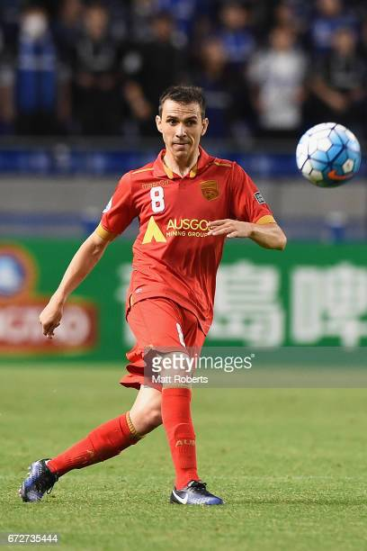 Isaias of Adelaide United passes the ball during the AFC Champions League Group H match between Gamba Osaka v Adelaide United at Suita City Football...