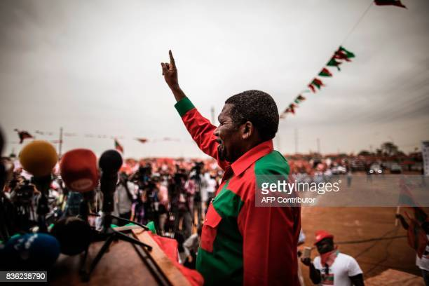 TOPSHOT Isaias Samakuva presidential candidate for Angola's main opposition National Union for the Total Independence of Angola acknowledges...