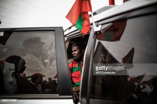 TOPSHOT Isaias Samakuva presidential candidate for Angola's main opposition National Union for the Total Independence of Angola talks to supporters...