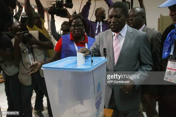 Isaias Samakuva the presidential candidate for the National Union for the Total Independence of Angola casts his vote in Luanda on August 23 2017...